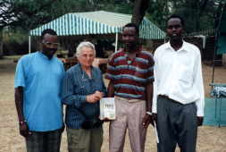 Stephen, Naomi, Kibai, and Musa pose in the Reserve compound, March 2, 2000.